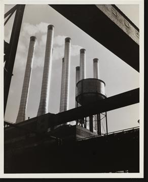 The conveyors at the Rouge plant of the Ford Motor Company were used by the photographer here to form an unusual geometric frame for the eight huge smokestacks at the plant.