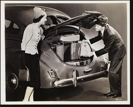 "The Streamline Luggage Locker in the new 1939 De Soto, which eliminates the old-fashioned trunk ""bustle,"" has 23 cubic feet of usable trunk space, 27 percent more than the big trunk on the 1938 De Soto models. Fitting right into the smooth flowing contours of De Soto's new streamline styling, the luggage locker is completely concealed. It is equipped with an anti-theft lock."