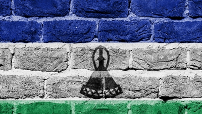Very old brick wall with flag of Lesotho. (Shutterstock)