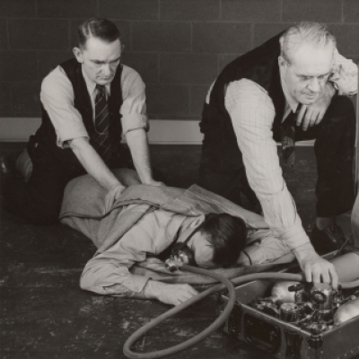 Close-up of practicing proper method of resuscitation--Gary Works